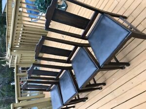 FOUR NICE SOLID WOODEN ANTIQUE CHAIRS WITH BLACK LEATHER SEATS
