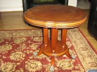 Circular coffee table in Rosewood colour