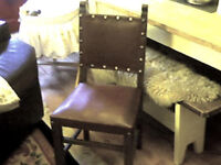 4 antique oak and leather sprung seated dining chairs
