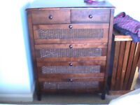 wooden chest of drawers and bedside cabinet