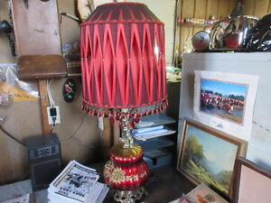 two mid century red diamond lamps chain and table
