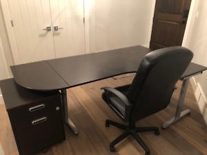 Desk with filing cabinet and faux leather chair