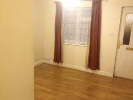 One bedroom ground floor flat with large refurbished cellar, parking space and 2mins from Bushey Stn