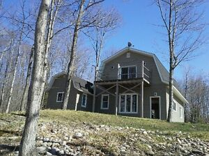 waterfront home for rent in Goulais - rustic lot, modern home