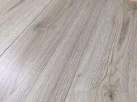 the cheapest landlord laminate flooring (grey oak) £4.95m2