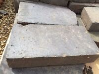 250 reclaimed blue bricks in good condition.