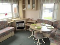 Cheap starter static caravan for sale, Sea views, dog friendly, heated indoor and outdoor pool !