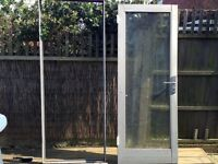 Private sale - good condition left-hinged aluminium grey double-glazed door with frame and 3 keys