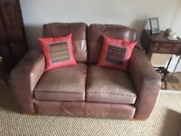 Brown distressed leather sofa