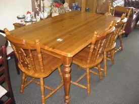 Dining table with chairs.