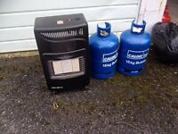 Calor gas heater and 2 empty bottles