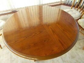 Large round table pedestal leg and 4 chairs with cushions