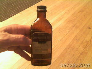 old brown GLASS BOTTLE - National Camphorated Oil B.P.