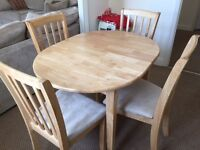 Oval dining table and matching upholstered chairs