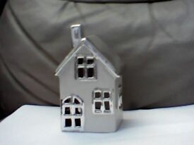 Tea light candle holder house