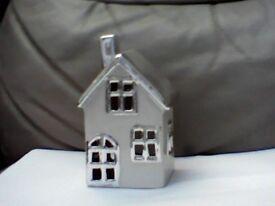 Tea light candle holder house