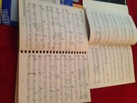 Collection of sheet music and books for piano , organ or singer