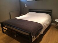 King sized bed (Modern, simple black frame with mattress thrown in for free)