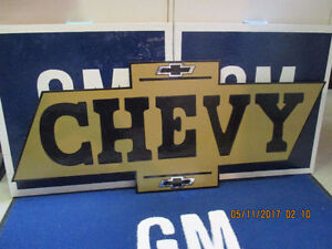 GOLD CHEVY SIGN.