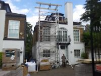 double young man scaffolding tower 4 sections high with extended support legs