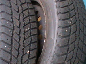 TWO WINTER TIRES AND RIMS 185/65R14 OFF OLDER TOYOTA
