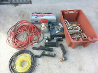 Box of tools, ext cords, trailer hitches, plumbing, jack, etc.