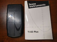 Texas Instruments TI-83 Plus graphing calculator with manual