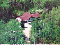 Well Maintained Country Home on 20 Treed Acres!!