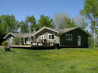 Beautiful Family Style Acreage - Welcome Home!