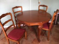 Beautiful carved wood extending table and 4 matching chairs