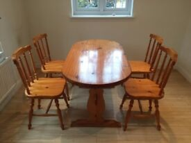 wooden dinner table and chairs