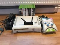 Xbox 360, 3 controllers, wifi adaptor and 14 games.