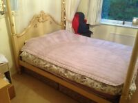 Four poster bed frame for sale.