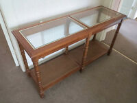 Pretty console table, inlaid glass top & storage wicker shelf below, ideal vanity cabinet, lamp desk