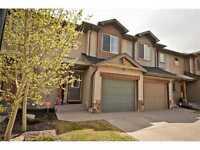For Rent Cochrane Town house on golf course, fully developed!!