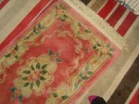 THICK QUALITY EXPENSIVE HEAVY RUG, MAIN COLOUR IS PINK WITH A FLORAL DESIG