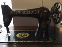 Singer 66 lotus treadle sewing machine.In wooden cupboard with accessories. F serial number