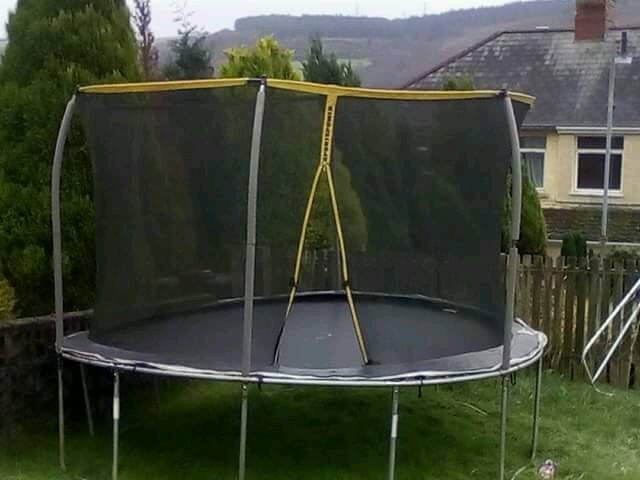 Free!!!!! 12 ft trampoline with sturdy enclosure. Buyer to collect and dismantle . free.