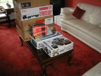Brand New Tamiya Job lot of RC 1.14 scale Trucks, trailers, buggies and extras.