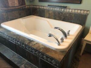 Maax 2 person soaker tub and moen faucet set
