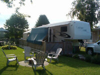 Carriage Cameo 5th Wheel set up with deck in 55+ Bayfield Park