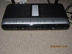 Telus modem/router,, very good condition  Actiontec, model T1200