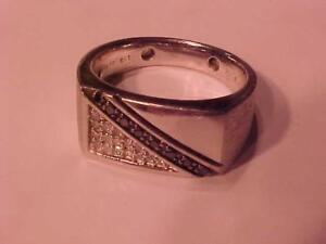 #3443-STERLING SILVER Mans dress ring  Size 11--Over 1/3 carat of Black & White Diamonds Appraised $650.00 sell $325.00