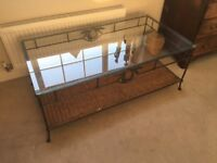 Wrought iron, wicker and glass coffee table