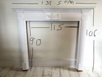 White painted wooden fireplace surround
