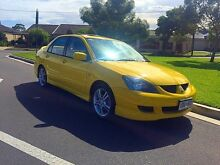 2005 Mitsubishi Lancer CH MY05 VR-X Yellow 4 Speed Sports Automatic Sedan North Brighton Holdfast Bay Preview