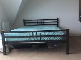 King size bed and mattress. Black metal frame