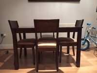 Dark wood Dinning table with 4 chairs