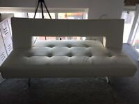 Dwell sofa bed in white faux leather