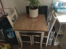 two seater dining table and chairs, stripped pine top with cream legs,,